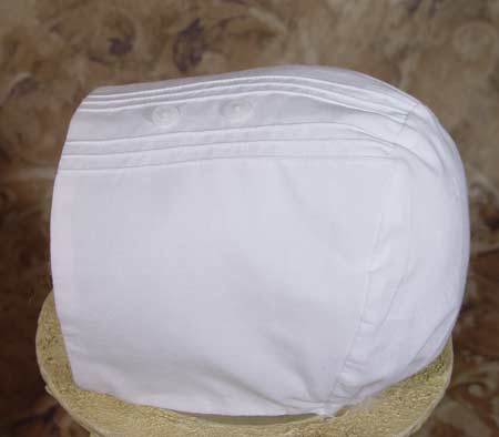 Close-up of Christening Outfit Bonnet