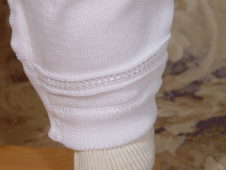 Close-up of Christening Outfit Leg